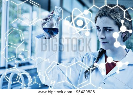 Science graphic against chemist looking at a blue liquid