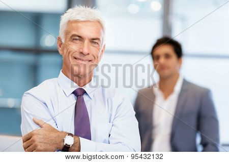 Portrait of businessman with collegue on background