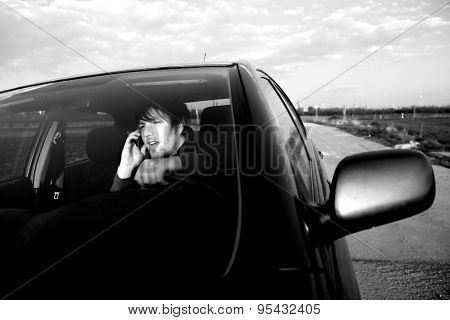 Man calling on the phone while driving