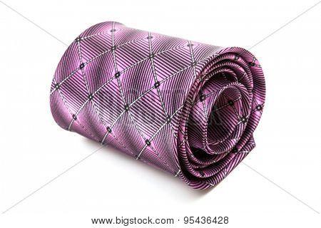 folded purple necktie on a white background
