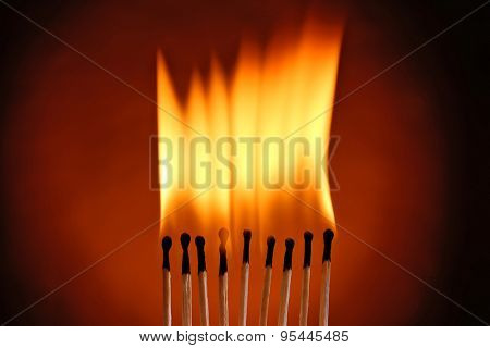 Burning matches on dark color background
