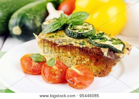 Casserole with vegetable mallow in white plate on table, closeup