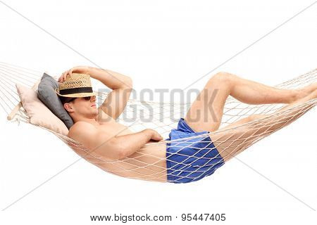 Young guy in blue swim trunks sleeping in a hammock isolated on white background
