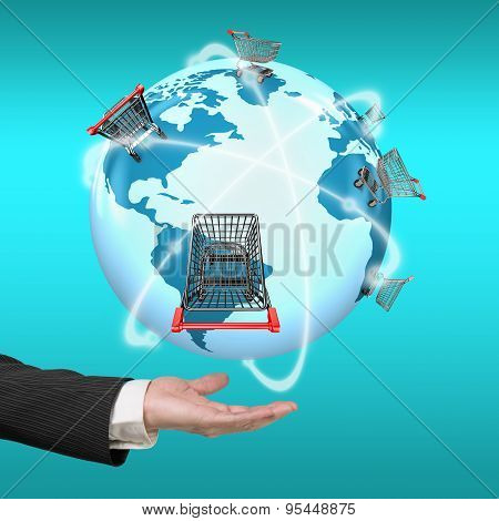 Hand Showing 3D Globe World Map Of Shopping Carts Worldwide