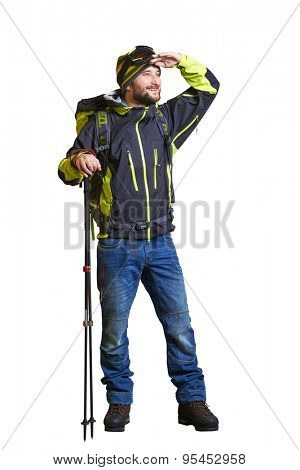 full length portrait of smiley hiker with backpack and hiking poles. looking forward. isolated on white background