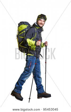 full length portrait of walking smiley hiker with backpack and hiking poles. isolated on white background