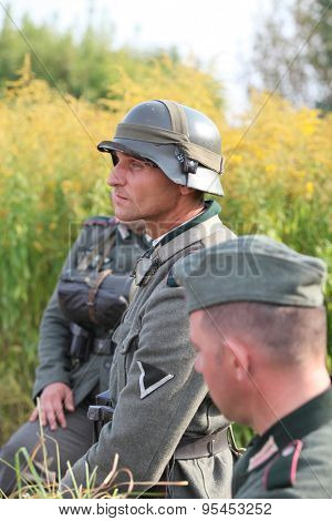 SOCHACZEW, POLAND - JUNE 12: Members of military club from Sochaczew during historical military reenacting on JUNE 12, 2013 in Sochaczew, Poland.