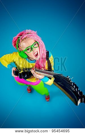 Female rock star playing the electric guitar. Bright style. Show business.