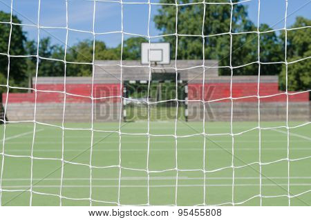 Blurred Background Of Outdoor Playground Through Soccer Goal Net