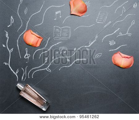 Fragrance Bottle With Drowing Smell Androse Petal On The Blackboard