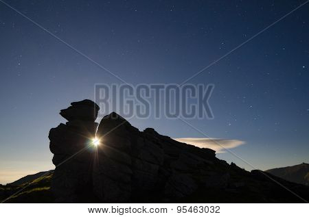 Moon light in the rock. Night landscape in the mountains. Carpathians, Ukraine, Europe
