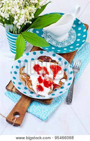 Delicious pancakes on the wooden kitchen table