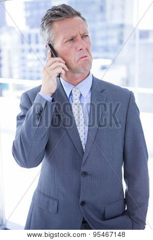 Angry businessman on the phone in the office