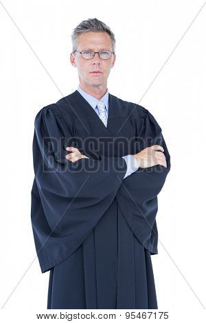 Serious lawyer looking at camera on white background