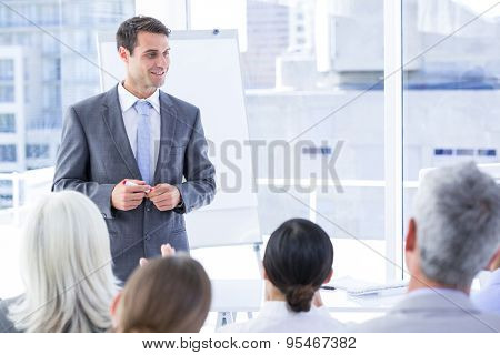 Business team looking at white screen in the meeting room