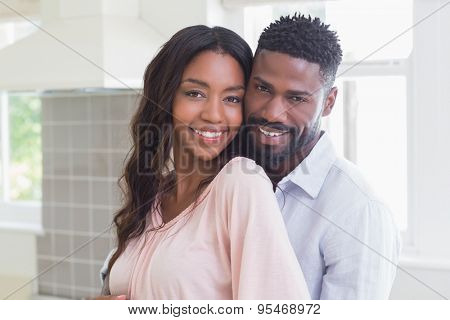 Happy couple spending time together at home in the kitchen