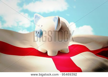 Piggy bank against blue sky