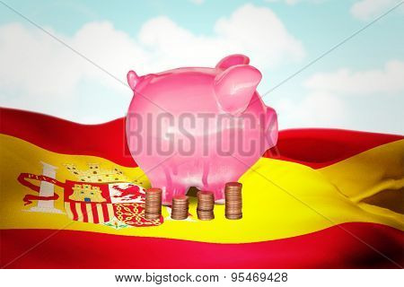 Coins and piggy bank against blue sky
