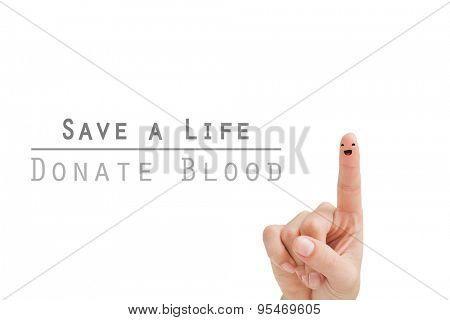 Blood donation against finger with smiley face