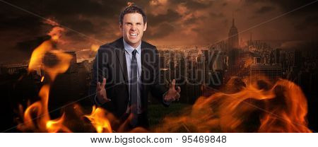 Stressed businessman gesturing against stormy sky over city