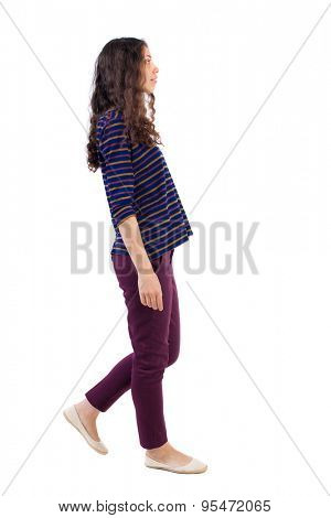 side view of walking woman.   beautiful blonde girl in motion.  backside view of person.  Rear view people collection. Isolated over white background. Curly girl in red pants is right.