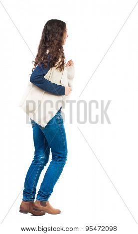 back view of running  woman. beautiful girl in motion. backside view of person.  Rear view people collection. Isolated over white background. Girl in sheepskin jerkin Runs right.