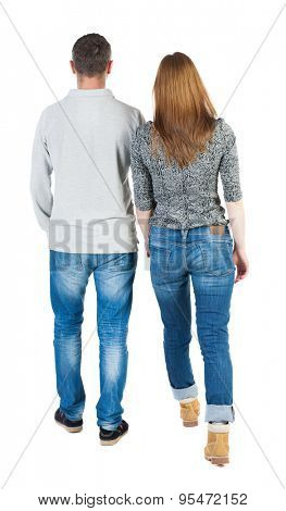 Back view going couple. walking friendly girl and guy holding hands. Rear view people collection. backside view of person.  Stylish couple holding hands walking near each other.