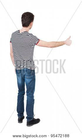Back view of  man in shirt shows thumbs up.   Rear view people collection.  backside view of person.  Isolated over white background.  The guy in the striped shirt taxi.