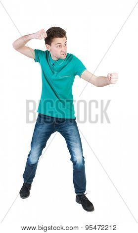 back view of skinny guy funny fights waving his arms and legs. Isolated over white background. Rear view people collection.  backside view of person. The guy in green shirt in funny pose bakserskoy