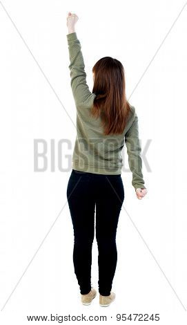 back view of dancing young beautiful  woman. girl  watching. Rear view people collection.  backside view of person.  Isolated over white background. A woman in a gray sweater in pose Superman flying.