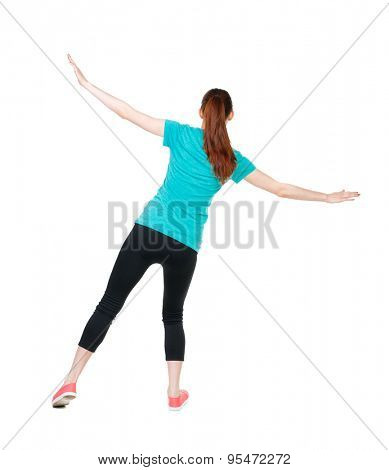 Back view woman Balances waving his arms.   Standing young girl in parka. Rear view people collection.  backside view of person.  Isolated over white background. Sports girl is balancing on the rope.
