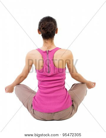 Back view of the girl sitting in front of a warm up exercise.  Rear view people collection. Isolated over white background. African-American woman sitting in the lotus position and meditating.
