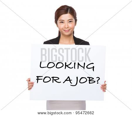 Asian businesswoman holding a placard showing with looking for a job phrases