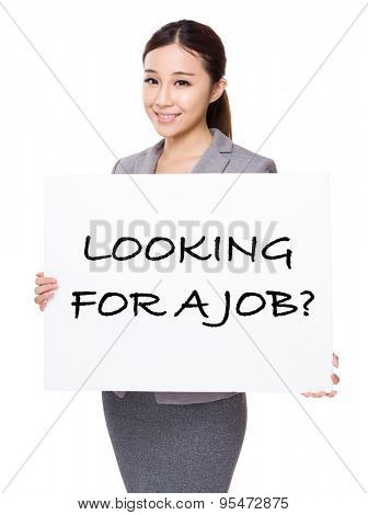 Beautiful businesswoman holding a placard showing with looking for a job phrases
