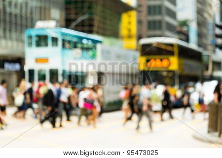Blur view of Crosswalk and pedestrian at street in hong kong