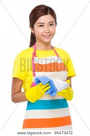 Young housewife wash the dishes