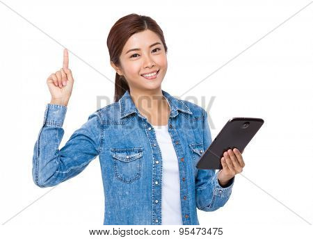 Young woman hand holding wit tablet and finger point upwards