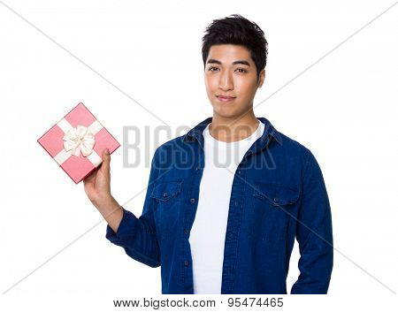 Iranian mixed man holding the red present box