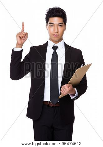 Young businessman holding with clipboard and finger point up