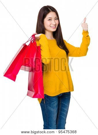 Asian woman hold with shopping bag and thumb up