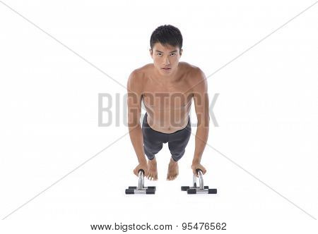 Portrait of muscular young man lifting weights on white background