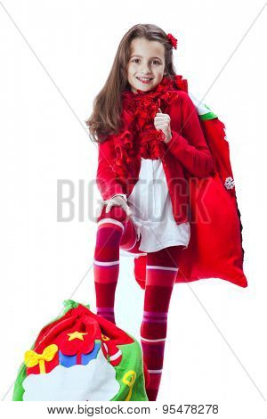 Little girl holding the santa claus bag
