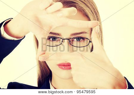 Beautiful caucasian businesswoman gesturing rectangle