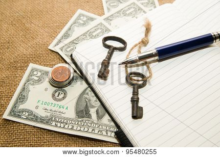 Opened Notebook, Pen, Keys And Money On The Old Tissue