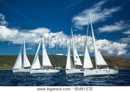 POROS - ERMIONI, GREECE - CIRCA MAY, 2014: Sailboats participate in sailing regatta 11th Ellada 2014 among Greek island group in the Aegean Sea, in Cyclades and Argo-Saronic Gulf.