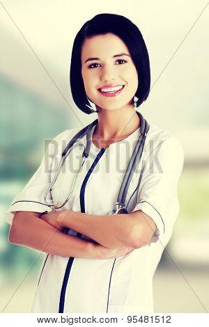 Happy female doctor wearing stethoscope