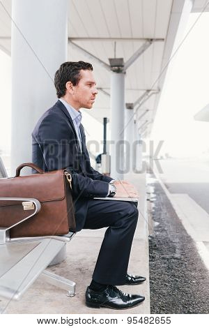 Businessman At Bus Station
