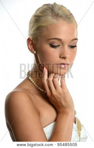 Portrait of beautiful young woman with hand on side of face isolated over white background
