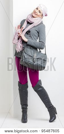 woman wearing winter clothes with a handbag