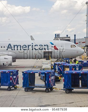 New York, USA - June 19th, 2015: American Airlines passenger jet being loaded at JFK airport in New York.